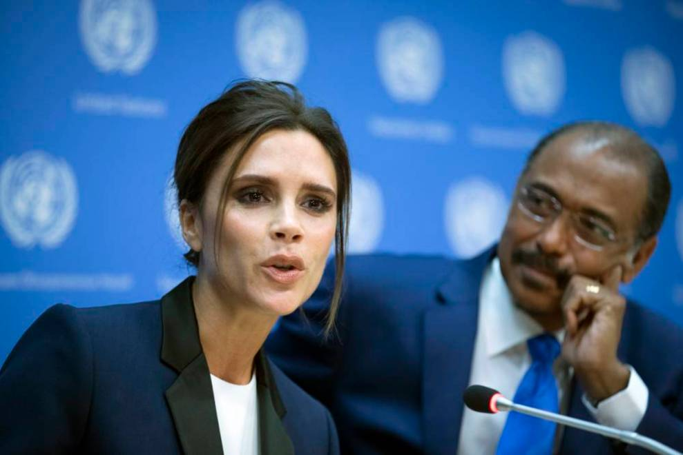 Fashion designer Victoria Beckham, left, speaks alongside Michel Sidibe, Executive Director of Joint UN Program on HIV/AIDS, during a news conference announcing her as a United Nation's Goodwill Ambassador during the 69th U.N. General Assembly at U.N. headquarters, Thursday, Sept. 25, 2014. (AP Photo/John Minchillo)